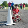 140609 Bike safety JOED VIERA/STAFF PHOTOGRAPHER-Lockport, NY- Evan Martin 2 rides his tricycle along an obstacle course during a bike safety event at Day Road Park. June 9, 2014