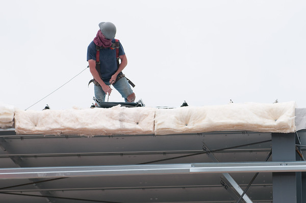 140604 Rink JOED VIERA/STAFF PHOTOGRAPHER-Lockport, NY-A worker installs insulation on the roof as construction continues on the Lockport Ice Arena. June 4, 2014.