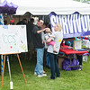 140614 Relay JOED VIERA/STAFF PHOTOGRAPHER-Lockport, NY-Skin cancer survivor Mike Kubiak plays with his granddaughter Annaleah Brandt 11 mo as she is held by his daughter Erin Cain at the survivor tent during the Relay for Life at Emmet Belknap. June 14, 2014