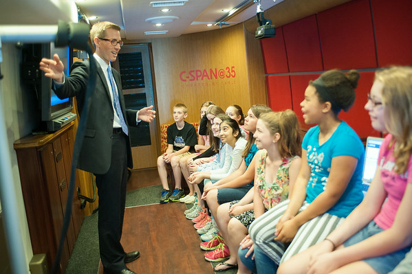 140618 JOED VIERA/STAFF PHOTOGRAPHER-Pendleton, NY-Josh Koning gives a Starpoint 6th grade class a tour of the C-SPAN bus at the school. June 19, 2014