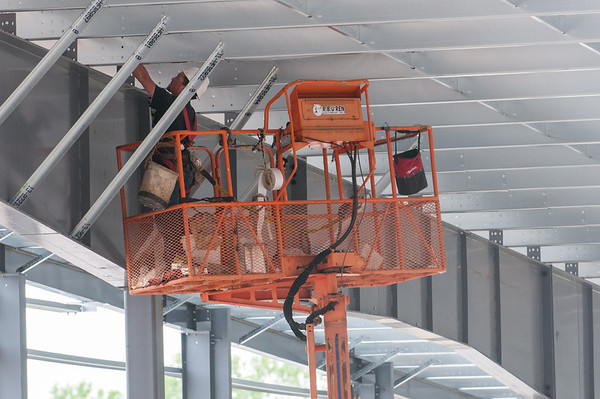 140604 Rink JOED VIERA/STAFF PHOTOGRAPHER-Lockport, NY- A Workers sprays the roof as construction continues on the Lockport Ice Arena. June 4, 2014.