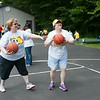 140618 JOED VIERA/STAFF PHOTOGRAPHER-Barker, NY-Campers Angela Castillo and Mary joe Cecconi play basketball during Camp Happiness at Camp Kenan . June 18, 2014