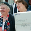 140630 JOED VIERA/STAFF PHOTOGRAPHER-Lockport, NY-American Legion Lady Auxilery Post president Ginger Lindner and post member Kathie McGinley smile after presenting boxes of goods that will be distrubted to food pantries and the needy at the VFW on June 30, 2014