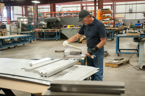 140626 JOED VIERA/STAFF PHOTOGRAPHER-Lockport, NY- Jack Karcher takes a look at plans berfore putting metal on a press brake at Diversified on June 26, 2014
