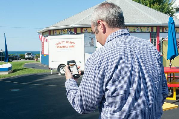 140627 JOED VIERA/STAFF PHOTOGRAPHER-Olcott, NY- PHOTO ILLUSTRATION-Jason Mollica checks out a audio description of Olcott's Carousel Park on his phone.