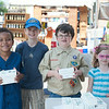 140628 JOED VIERA/STAFF PHOTOGRAPHER-Lockport, NY-Cub Scouts Vernon Henry, Drake Jarrell, Darren Jarell and Dakota Jarell raise money by selling fudge during the Lockport Arts & Crafts Festival. June 28, 2014