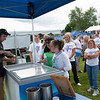 140614 Relay JOED VIERA/STAFF PHOTOGRAPHER-Lockport, NY-Relayers line up for a free scoop of Anderson ice cream at the the Relay for Life at Emmet Belknap. June 14, 2014