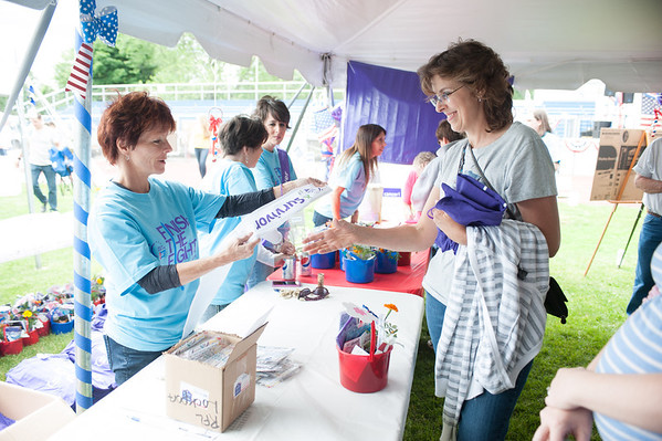 140614 Relay JOED VIERA/STAFF PHOTOGRAPHER-Lockport, NY-Cookie Butcher hands a sash to Lymphoma Survivor Debbie Porter for participating in the the Relay for Life at Emmet Belknap. June 14, 2014