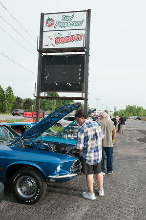 140610 Cruise night JOED VIERA/STAFF PHOTOGRAPHER-Pendleton, NY- George Morakis checks out a mustang parked outside of cruise night at The Dugout. June 10, 2014