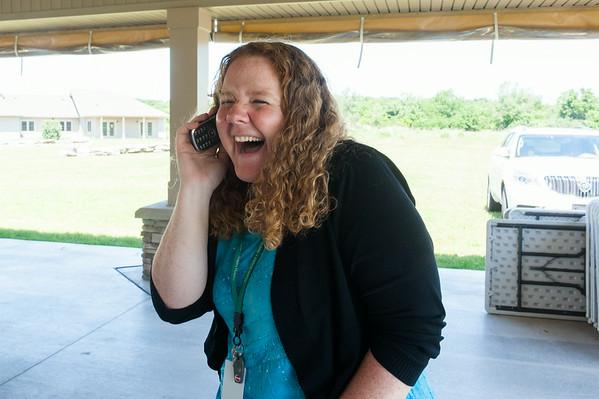 140626 JOED VIERA/STAFF PHOTOGRAPHER-Lockport, NY-Mandy Raff calls the winner of the 2014 Corvette Stingray at Niagara Hospice June 26, 2014