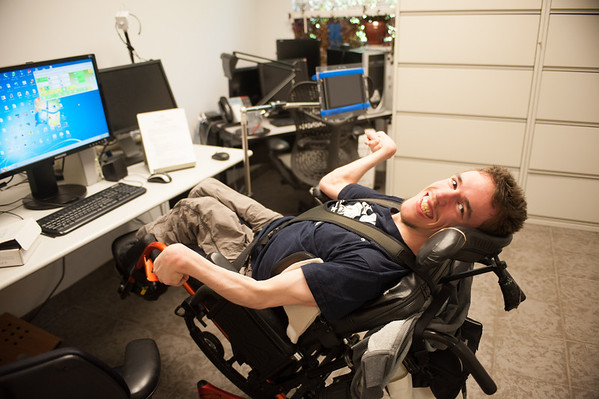 140613 JOED VIERA/STAFF PHOTOGRAPHER-Buffalo, NY-Andrew Cooper laughs as he works on a computer at the Center for Assistive Technology.