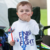 140614 Relay JOED VIERA/STAFF PHOTOGRAPHER-Lockport, NY-Michael Liddaugh 5 eats a pretzel at the the Relay for Life at Emmet Belknap. June 14, 2014