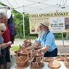 140628 JOED VIERA/STAFF PHOTOGRAPHER-Lockport, NY-Sherrie and Chris Robins check out collapsible baskets made by woodworker Jonas Shroc at the Lockport Arts & Crafts Festival. June 28, 2014