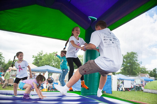 140614 Relay JOED VIERA/STAFF PHOTOGRAPHER-Lockport, NY-Kids play in a bounce house during the Relay for Life at Emmet Belknap. June 14, 2014