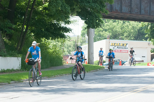 140630 JOED VIERA/STAFF PHOTOGRAPHER-Lockport, NY-Journey along the Erie Canal riders cycle down the Market Street hill on June 30, 2014.