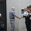 140602 Enterprise JOED VIERA/STAFF PHOTOGRAPHER-Lockport, NY-Lockport Police officers congratulate Steve Ritchie as he exits the police station. June 2, 2014.
