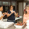 140614 Wilson BBQ JOED VIERA/STAFF PHOTOGRAPHER-Wilson, NY-BBQ contest volunteers Cecilia Jackson and Melba Lindsey enjoy the contests leftovers on June 14, 2014