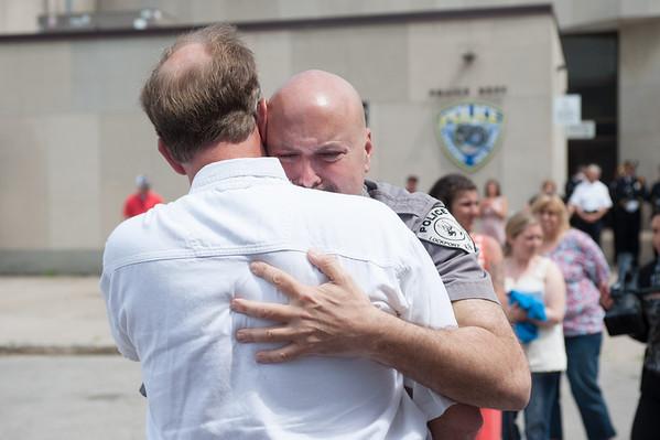 140602 Enterprise JOED VIERA/STAFF PHOTOGRAPHER-Lockport, NY-Recent LPD retiree Scott Seekins congratulates Steve Ritchie as he exits the police station. June 2, 2014.