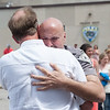 140602 Enterprise JOED VIERA/STAFF PHOTOGRAPHER-Lockport, NY-Recent LPD retiree Scott Seekins congratulates Steve Ritchie as he exits the police station. June 2, 2014.