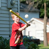 140618 JOED VIERA/STAFF PHOTOGRAPHER-Lockport, NY-Shane Erle 8 plays wiffleball on Hawley St. June 17, 2014