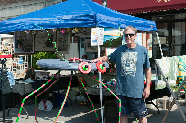 140628 JOED VIERA/STAFF PHOTOGRAPHER-Lockport, NY-Rick Reid  stands by his giant button bug at  the Lockport Arts & Crafts Festival. June 28, 2014