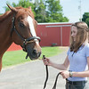 140618 JOED VIERA/STAFF PHOTOGRAPHER-Middleport, NY-Alissa Zwelling guides her horse Charlotte . June 18, 2014