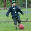 140618 JOED VIERA/STAFF PHOTOGRAPHER-Barker, NY-Camper Justin Shaw kicks a home run during Camp Happiness at Camp Kenan . June 18, 2014