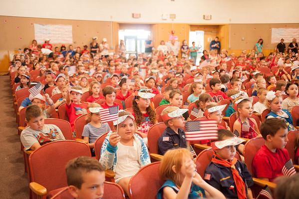 140613 Royhart JOED VIERA/STAFF PHOTOGRAPHER-Gasport, NY- Roylton Hartland Students hold up flags druing a school assembly. June 13, 2014