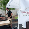 140614 Wilson BBQ JOED VIERA/STAFF PHOTOGRAPHER-Wilson, NY- Woodcock Brewery's Jacob Held cooks up some BBQ for a contest on June 14, 2014