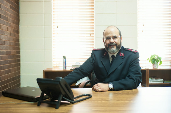 140630 JOED VIERA/STAFF PHOTOGRAPHER-Lockport, NY-The Salvation Army's new Major José Santiago sits at his desk on June 30, 2014.