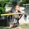 140618 JOED VIERA/STAFF PHOTOGRAPHER-Lockport, NY-Austin Erle 11 plays wiffleball on Hawley St. June 17, 2014