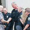 140602 Enterprise JOED VIERA/STAFF PHOTOGRAPHER-Lockport, NY-Lockport Police Officer Steve Abott congratulates Steve Ritchie on his retirement June 2, 2014.