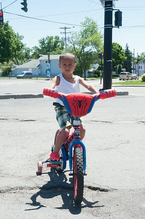 140619 JOED VIERA/STAFF PHOTOGRAPHER-Lockport, NY-Tyvon Bruce rides his spiderman bike down Washburn Street. June 19, 2014