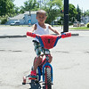 140619 JOED VIERA/STAFF PHOTOGRAPHER-Lockport, NY-Tyvon Bruce rides his spiderman bike down Washburn Street. June 19, 2014