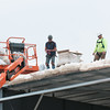 140604 Rink JOED VIERA/STAFF PHOTOGRAPHER-Lockport, NY-Workers install insulation on the roof as construction continues on the Lockport Ice Arena. June 4, 2014.