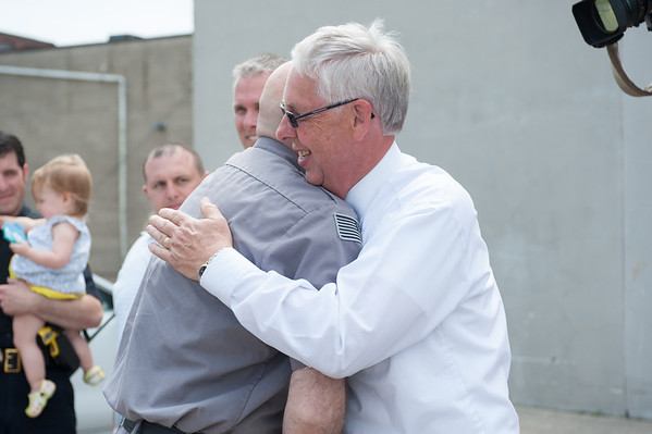 140602 Enterprise JOED VIERA/STAFF PHOTOGRAPHER-Lockport, NY-Recent LPD retiree Rick Podgers congratulates Steve Ritchie as he exits the police station. June 2, 2014.