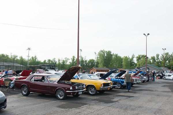 140610 Cruise night JOED VIERA/STAFF PHOTOGRAPHER-Pendleton, NY-Parked mustangs line up outside with thier hoods open during cruise night at The Dugout. June 10, 2014