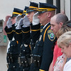 140602 Enterprise JOED VIERA/STAFF PHOTOGRAPHER-Lockport, NY-The LPD salutes Steve Ritchieas he exits the police station. June 2, 2014.
