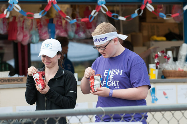140614 Relay JOED VIERA/STAFF PHOTOGRAPHER-Lockport, NY-Haley Waple and Ewings Sarcoma survivor Jack Langdon eat some tacos in a bag at the the Relay for Life at Emmet Belknap. June 14, 2014