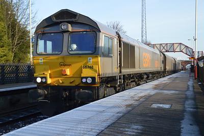 66748 1257/4n61 Drax-Tyne Dock passes Knottingley.