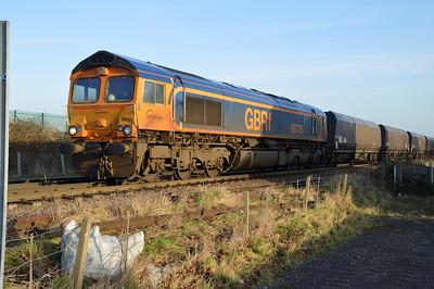 66735 1353/4n92 Drax-Tyne Dock passes Womersley Road Crossing.