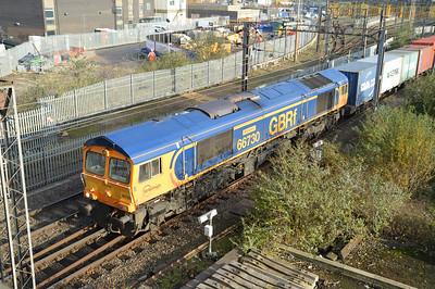 66730 1314/4m23 Felixstowe-Hams Hall passes Willesden Junction.