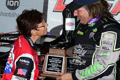 """Harriett Chancellor in Victory Lane with Scott Bloomquist for the 1st Cowboy Classic in memory of her late husband Allen """"Cowboy"""" Chancellor"""