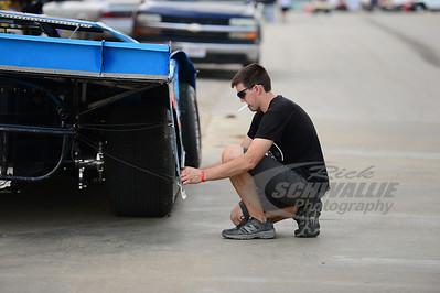 Garrett Alberson applies decals to his car