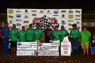 Jimmy Owens and crew in Victory Lane