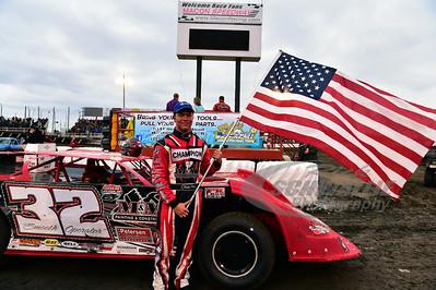 Bobby Pierce holding the American Flag
