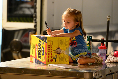Jason Hughes' daughter gets in some coloring on top of the pit cart.
