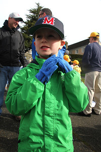 The torrential rain lets up just long enough to march in the Magnolia Little League season kick-off parade