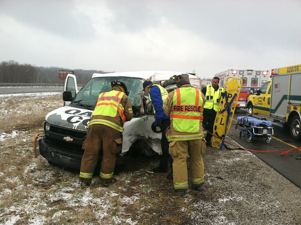 Fire rescue personnel attend to Scott A. Dixon, 55, of Terre Haute after he lost control of the 2007 Chevrolet van he was driving early this morning on Interstate 70 in Putnam County. (Submitted photo)