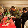 140319 St. Josephs JOED VIERA/STAFF PHOTOGRAPHER-Lockport, NY- Fred Thompson picks up food at All Saints Parish for the St Josephs feast on Wednesday, Mar. 19th, 2014.